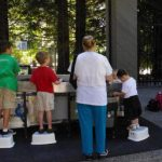 Kids and mom at sand table