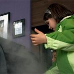 Girl playing with fog exhibit