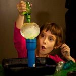 Child experimenting with science