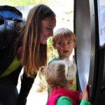 Kids at cascade wall exhibit