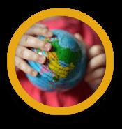 Hands holding a world globe like a ball