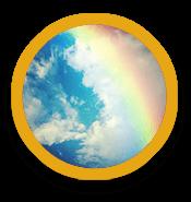 Rainbow across cloudy sky