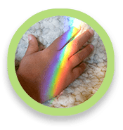 Rainbow lighting up a person's hand