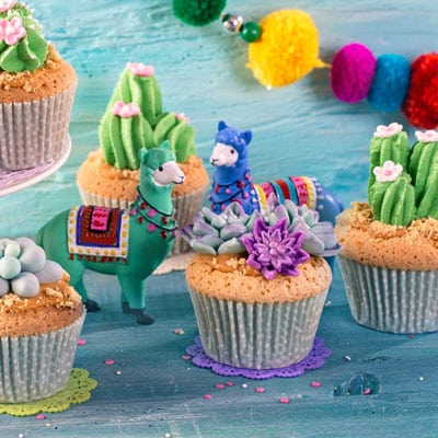Frosted cupcakes and toy llamas