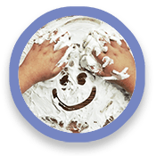 Pair of hands and smiley face drawn in shaving cream